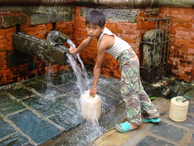 Boy fetching water KTM